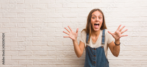 Young hipster woman celebrating a victory or success Canvas-taulu
