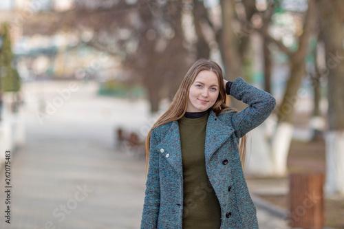 Fototapety, obrazy: Girl in a coat in the alley on the Volga river in Cheboksary