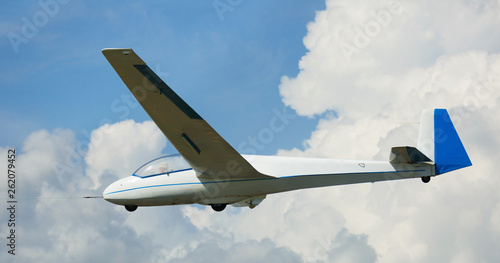 Airframe hovering highly in the sky on a background of clouds Canvas Print