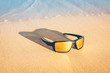 sunglasses on the sandy seashore - holiday season - rest on the ocean