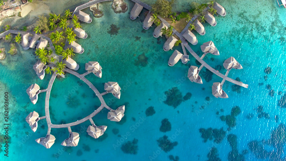 Fototapeta TOP DOWN Spectacular drone shot of exotic island landscape and rich hotel resort