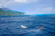 AERIAL: Teahupoo Wave Approaching The Young Local Surfer In French Polynesia.