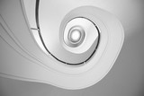 Spiral stairway. Bottom view. Geometry in architecture. - 262096665