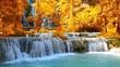 Cascade of beautiful Kuang Si waterfall sometimes spelled Kuang Xi