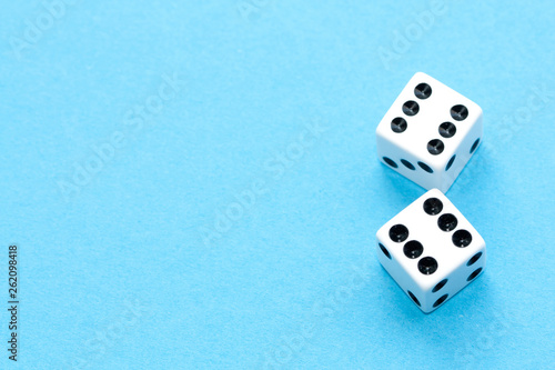Gaming dices on blue background. Canvas Print
