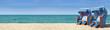 Leinwandbild Motiv Strandpanorama mit zwei blauweissen Strandkörben