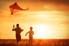 Children With A Kite At Sunset