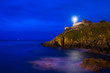 canvas print picture - Cityscape of the lighthouse village of Cudillero at night (Asturias, Spain)