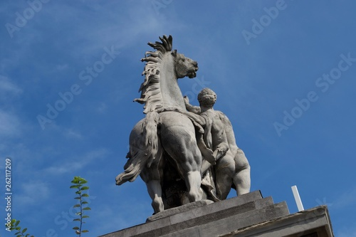 Rear view of statue of horse and man - naked against blue sky Wallpaper Mural