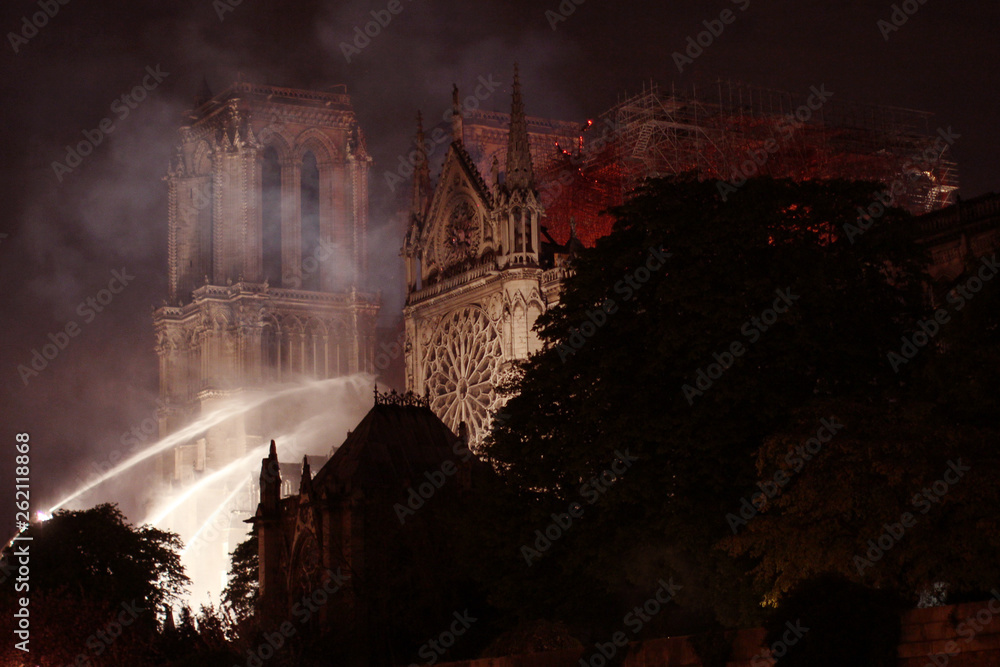 Fototapety, obrazy: Burning roof of Notre Dame cathedral on April 15th, 2019 in Paris, Frrance.