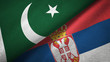 Pakistan and Serbia two flags textile cloth, fabric texture