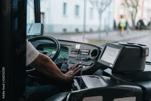 Modern bus interior with drivers hand