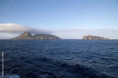 Fotografie, Obraz  The stunning Nightingale Island with an amazing cloud formation of a blue sea