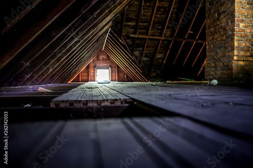 Fotografie, Obraz Old attic space with roof rafters and a window