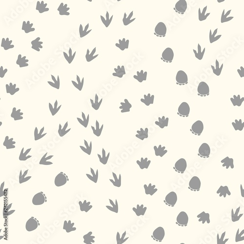 fototapeta na drzwi i meble Seamless repeat pattern with dinosaur tracks
