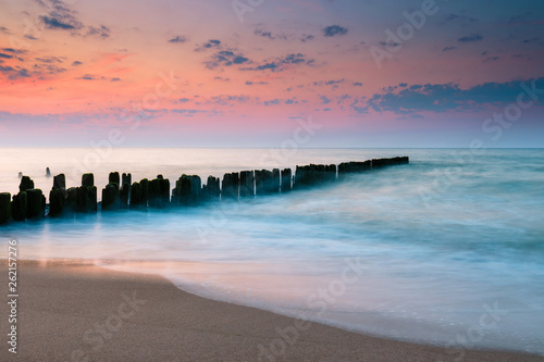 Valokuva  Breakwater at beautiful sunset, Baltic Sea, Poland