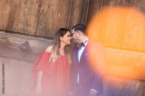 Foto op Aluminium Dance School Attractive couple posing outdoor in front of old wooden door