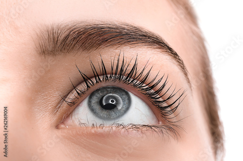 Obraz na plátne Beautiful young woman after eyelashes lamination, closeup