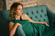 canvas print picture - Elegant young woman in green evening dress posing in vintage interior