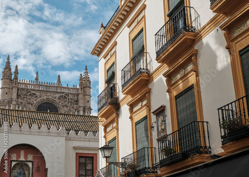 Fotografie, Obraz  Typical facade of Seville and Cathedral of Saint Mary of the See Seville,Andalusia, Spain