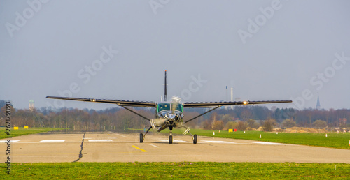 Türaufkleber Hubschrauber silver airplane landing on the airport, recreational sport and hobby, air transportation