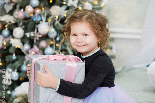 Fotografie, Obraz  Happy little girl with Christmas gift