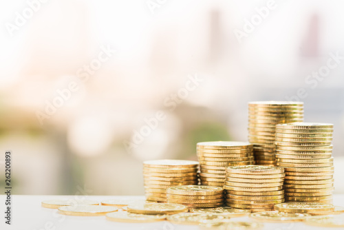 Fotografía  Close up of coins pile with city background, Money, Financial, Business Growth concept