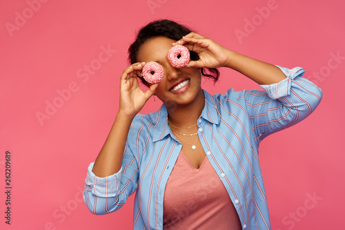 people, fast food and fun concept - happy african american young woman with donu Wallpaper Mural