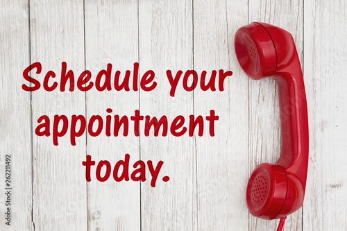 Photo Schedule your appointment today text with retro red phone handset