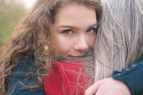 Fényképezés Lovely girl hugging her grandmoher