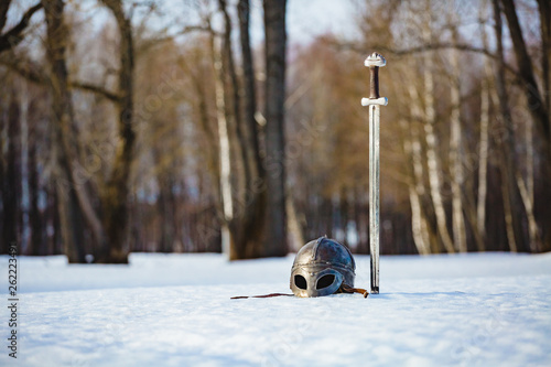 Fotografie, Tablou  Image of silver sword and helmet from Game of thrones