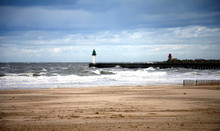 Windswept Beach With Lighthouse