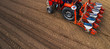 Leinwanddruck Bild - Aerial view of tractor with mounted seeder performing direct seeding