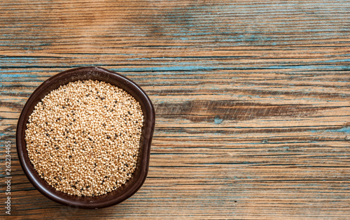 amaranth beans in bowl, on rustic wooden background Canvas Print
