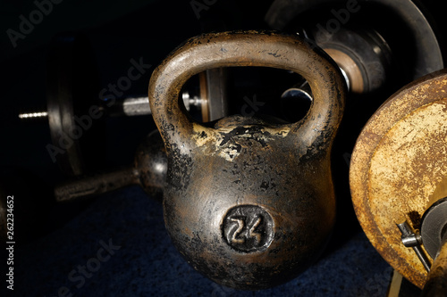Old and heavy kettlebell weight in dark room. Canvas Print