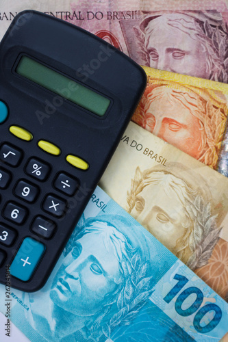 Brazilian money and calculator on a table. Economy concept image - 262245014