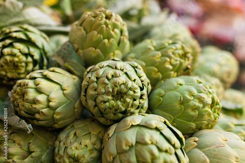 Fényképezés  Fresh artichokes on market counter