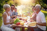 Family having a barbecue party in their garden - 262257232