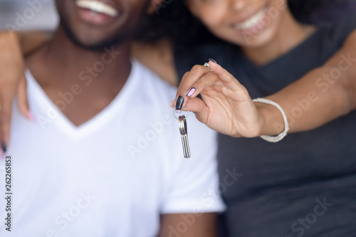 Close up happy African American woman holding, embracing man