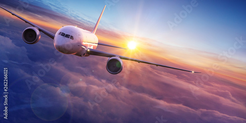 Türaufkleber Flugzeug Commercial airplane jetliner flying above dramatic clouds.