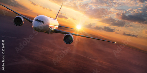 Ingelijste posters Vliegtuig Commercial airplane jetliner flying above dramatic clouds.