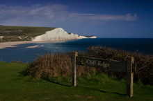 Cliff Edge Sign With Chalk Cliffs