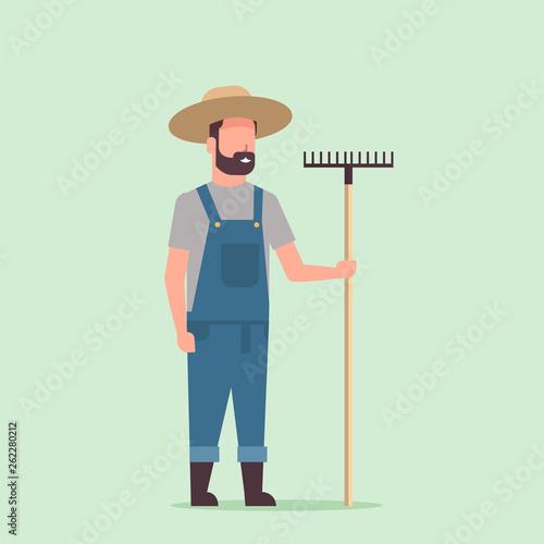 Pinturas sobre lienzo  gardener holding rake country man working in garden gardening eco farming concep