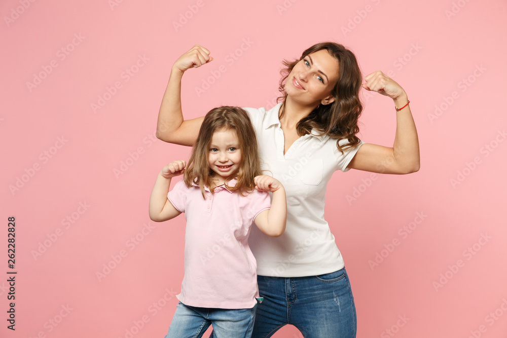 Fototapeta Woman in light clothes have fun with cute child baby girl. Mother, little kid daughter isolated on pastel pink wall background, studio portrait. Mother's Day, love family, parenthood childhood concept