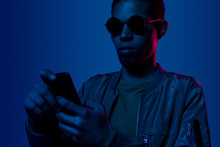 Young African Man Using Mobile...
