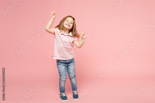 Little cute child kid baby girl 3-4 years old wearing light clothes dancing isolated on pastel pink wall background, children studio portrait. Mother's Day, love family, parenthood childhood concept. - 262284023