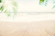 Abstract soft blur nature tropical beach with green coconut palm leaf and light wave bokeh background concept for blurry sky summer landscape water and sand, holiday ocean travel, relax vacation day