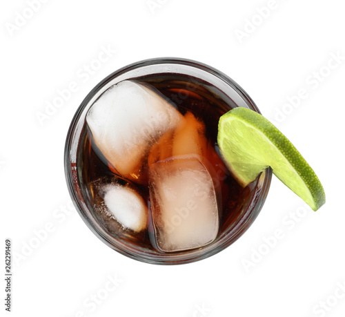 Fototapeta Glass of Rum and Cola cocktail on white background, top view. Traditional alcoholic drink obraz na płótnie
