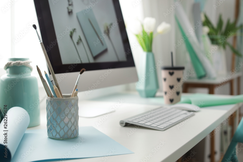 Fototapety, obrazy: Stylish workplace with modern computer on desk. Focus on pencil holder