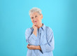 canvas print picture - Portrait of grandmother in stylish clothes on color background